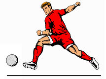 Striker kicking ball red Royalty Free Stock Photo
