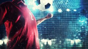 Striker player controls the ball near the football goal Stock Photos