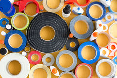 Striking abstract pattern of glue pots and tape Stock Photo