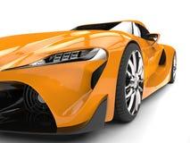 Striking amber modern super car - headlight extreme closeup shot Royalty Free Stock Photography