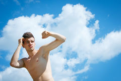 Striking athletic man Stock Images