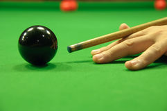 Striking the black ball Stock Photo