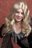 Striking blonde. Model in halloween dress and striking blond wig stock photo