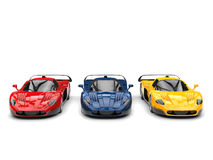 Striking concept sports cars in red, blue and yellow colors. Isolated on white background Royalty Free Stock Photo