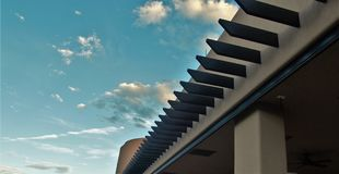 Southwestern Roof against New Mexico Sky. Striking constrast between the dark vega beams from an adobe building against the blue New Mexico sky royalty free stock photo