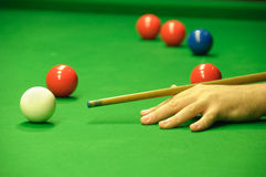 Striking the cue ball. Player striking the cue ball Stock Photos