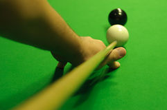 Striking the cue ball Stock Photo