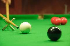 Striking the cue ball with a short rest Royalty Free Stock Photo