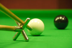 Striking the cue ball with a short rest Stock Photos