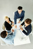 Striking deal. Above view of successful partners making deal after negotiations at meeting stock photography