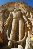 Striking enormous figure carved into the rock face of Maitreya B Royalty Free Stock Images
