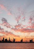 Striking golden clouds pattern during sunset, Bahrain skyline Stock Photos