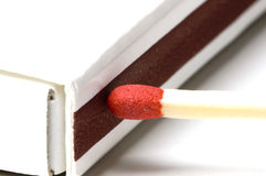 Striking a match. A red tipped match about to be struck Royalty Free Stock Photo