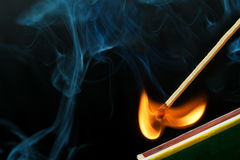 Striking a match and make a fire Royalty Free Stock Photo