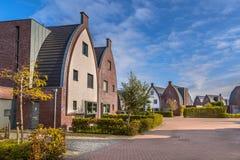 Striking modern family houses with playground Stock Photos