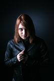 Striking red haired teen in black leather. Striking red headed teen in black leather jacket royalty free stock image