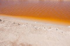 Striking red pool used in the production of salt near Rio Lagartos, Mexico, Yucatan.  Stock Photography