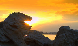 Striking rock lion mouth sunrising Stock Images