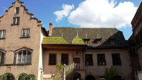 Striking the roof of the house in Germany. Colored tiles look very nice, vivid color Stock Photos