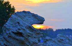 Striking stone monster breathing fire. Spectacular beach sunrise, stone figure like roaring lion fire-breathing , Chalkidiki  beach Greece Royalty Free Stock Photo