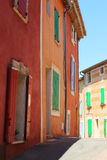 Strikingly colored houses, Roussillon, France Royalty Free Stock Photo
