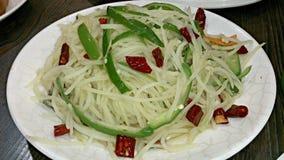 Strimlad potatis med paprika Royaltyfria Bilder