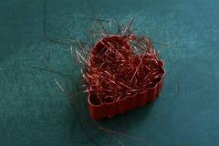 Strimlad röd hjärta Arkivbilder