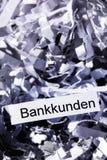 Strimlade pappers- bankkunder Arkivbild
