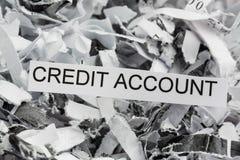Strimlat konto för pappers- kreditering Arkivfoton