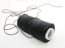 String. Spool of black cord isolated Stock Photo
