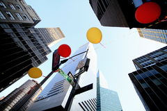 String of balloons with city buildings Royalty Free Stock Photo
