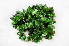 Beads from chrome diopside crystals on gray Royalty Free Stock Photography