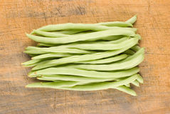 String bean and cutting board Stock Photography