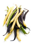 String beans. Pile of purple yellow and green string beans isolated on white Royalty Free Stock Image