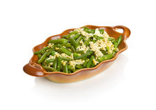 String beans with eggs. In a brown bowl Stock Image
