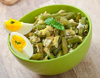 String beans with eggs. In bowl Royalty Free Stock Images