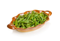 String beans with garlic. In a brown bowl Stock Photos