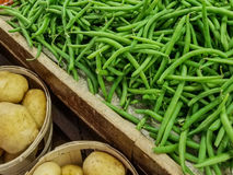 String Beans. And potatoes at a farmers market stock image