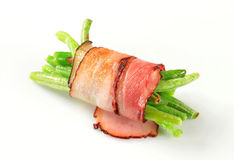 String beans wrapped in bacon. String beans wrapped in slices of bacon Royalty Free Stock Photography