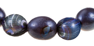 String of black glaze ceramic and silk beads Royalty Free Stock Photos