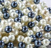 String of black and white pearls Royalty Free Stock Photos