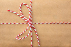 String bow against brown paper Stock Images