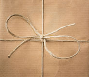 String bow against brown paper Royalty Free Stock Photo