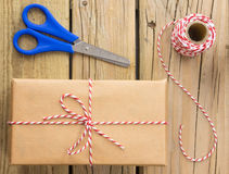 String and brown paper parcel with scissors and string Royalty Free Stock Photos