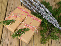 String and brown paper parcels with christmas decoration Stock Images