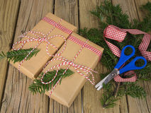 String and brown paper parcels with conifer decoration, check ri Royalty Free Stock Images