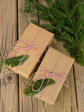 String and brown paper parcels with conifer decoration Royalty Free Stock Photography