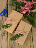 String and brown paper parcels with conifer decoration and ribbo Royalty Free Stock Images