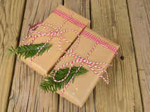 String and brown paper parcels decorated with conifer  and check Royalty Free Stock Image