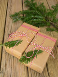 String and brown paper parcels decorated with conifer  Stock Image
